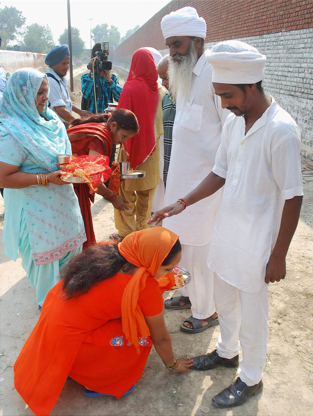 Women meeting their husbands who are prisoners in Central Jail Amritsar as jail authorities made spacial arrangements on the occasion of 'Karva Chauth' in Amritsar.