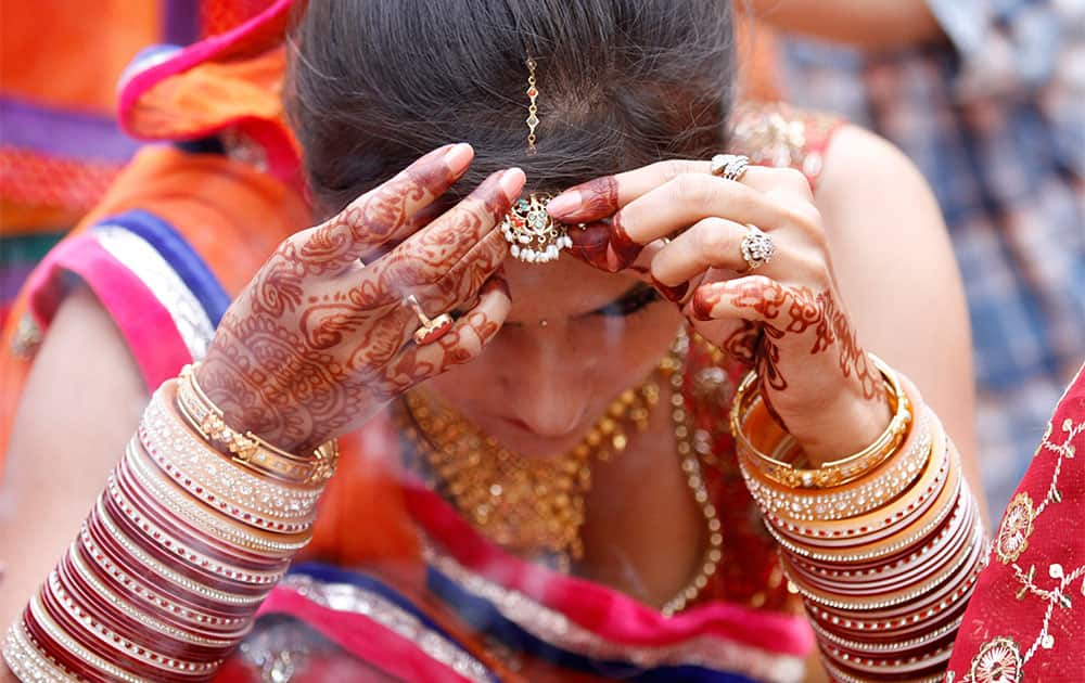 A married Hindu woman performs rituals on Karwa Chauth festival, in Allahabad.