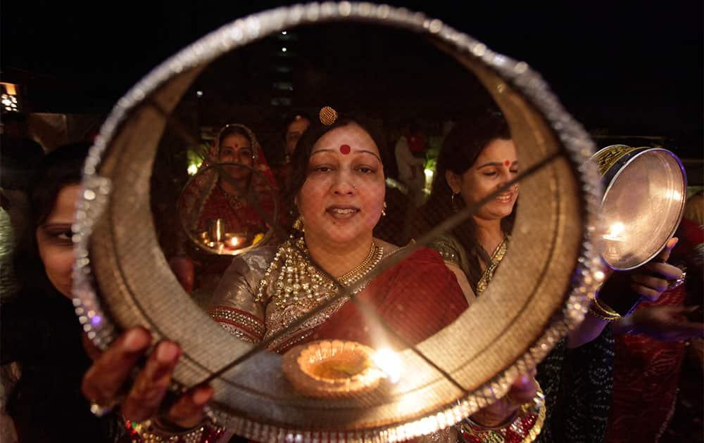 Married Hindu women perform rituals during 'Karwa Chauth' festival, in Ahmadabad.
