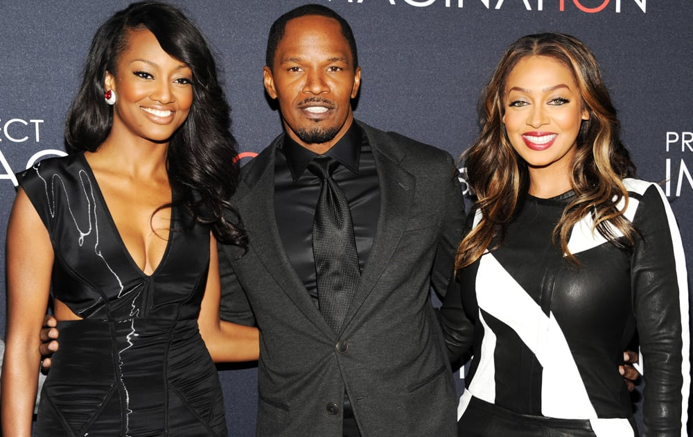 Actors Nichole Galicia, Jamie Foxx and La La Anthony attend the global premiere of Canon's