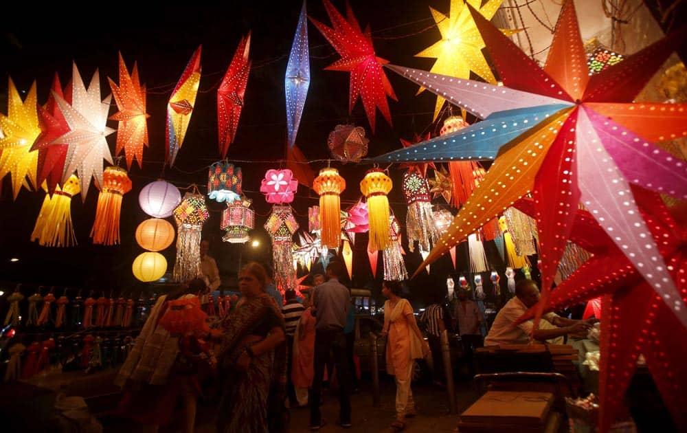 People buy lanterns from roadside stalls ahead of Hindu festival of lights Diwali, in Mumbai.