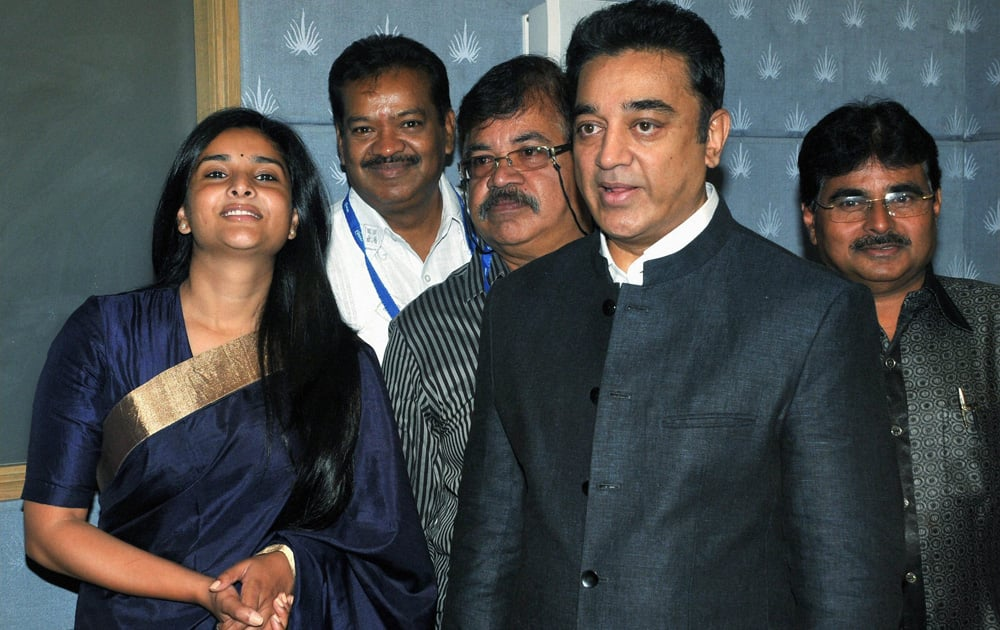 Southern superstar Kamal Haasan with Kannada actress & MP Ramya at a FICCI event in Bengaluru.