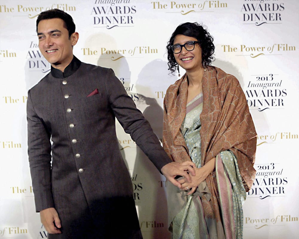 Aamir Khan and his wife Kiran Rao at America Abroad Media's 2013 Inaugural Awards Gala Dinner in Washington.