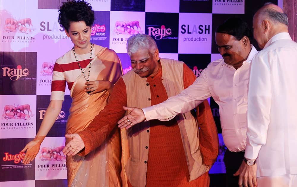 Actress Kangana Ranaut (L) with Indian Union Home Minister Sushil Kumar Shinde (R) during the music launch for the forthcoming Hindi film 'Rajjo' in Mumbai. Pic Courtesy: DNA