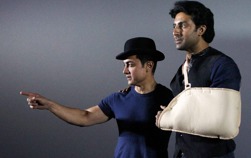 Aamir Khan with Abhishek Bachchan during the Dhoom: 3 promotions in Mumbai.