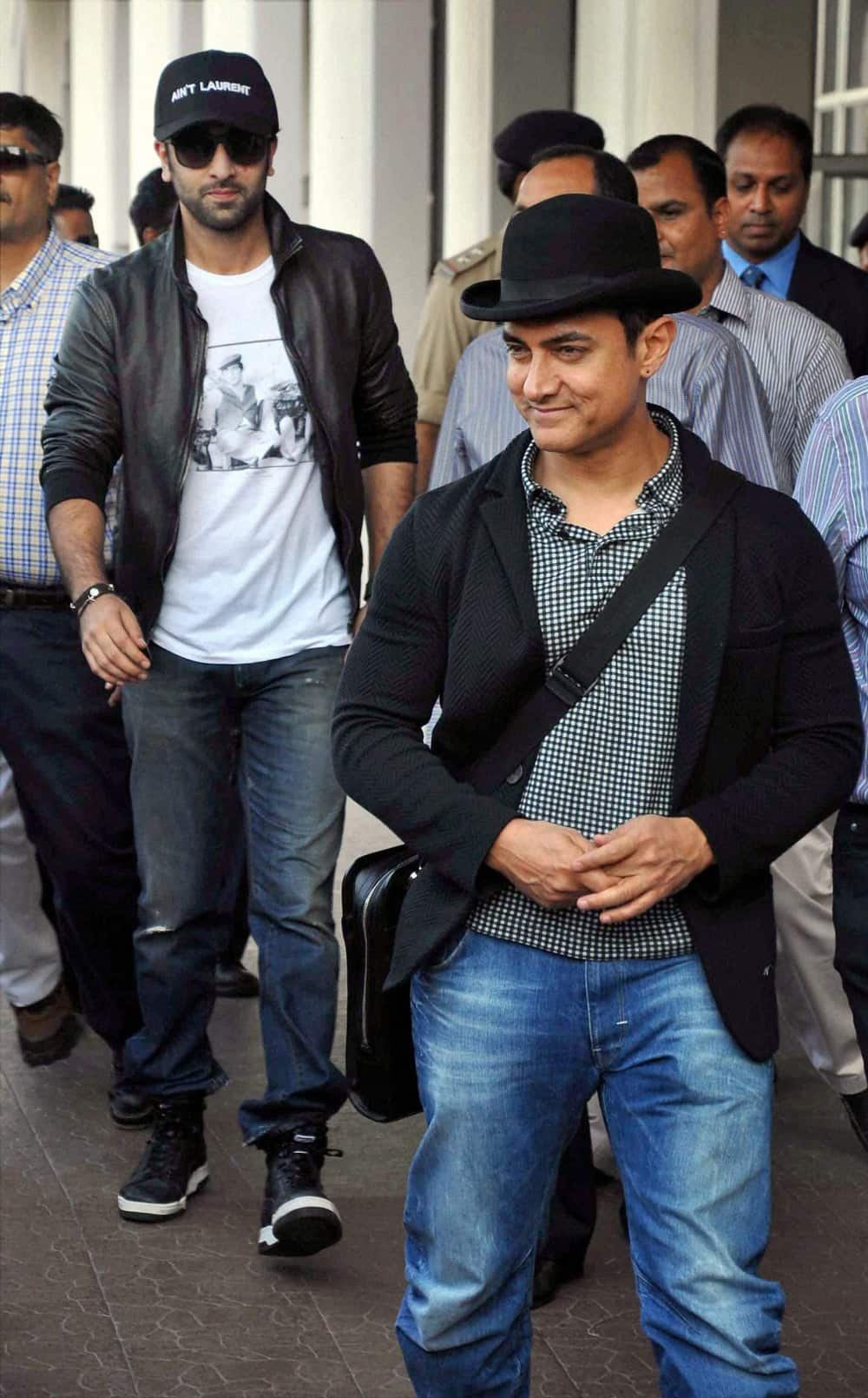 Aamir Khan and Ranbir Kapoor arrive at the airport in Jodhpur on Thursday to attend Nita Ambani's 50 birthday bash.