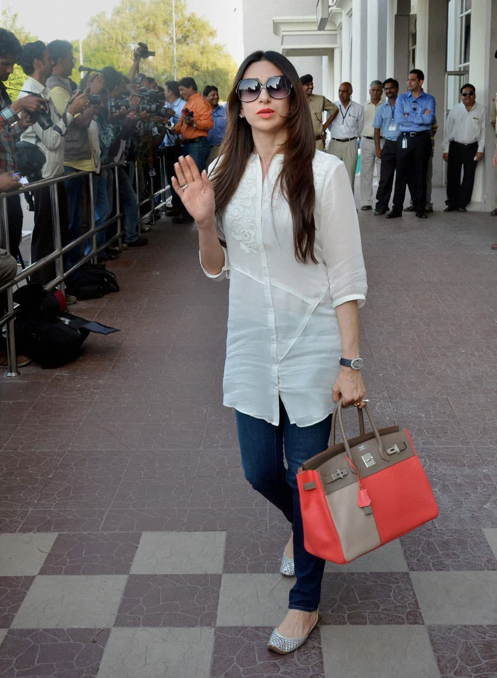 Karishma Kapoor arrives at the airport in Jodhpur on Thursday to attend Nita Ambani's 50 birthday bash.