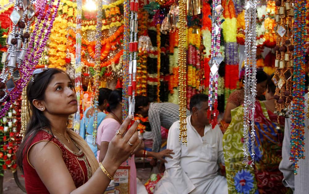 A woman shops for artificial garlands ahead of Diwali in Allahabad.