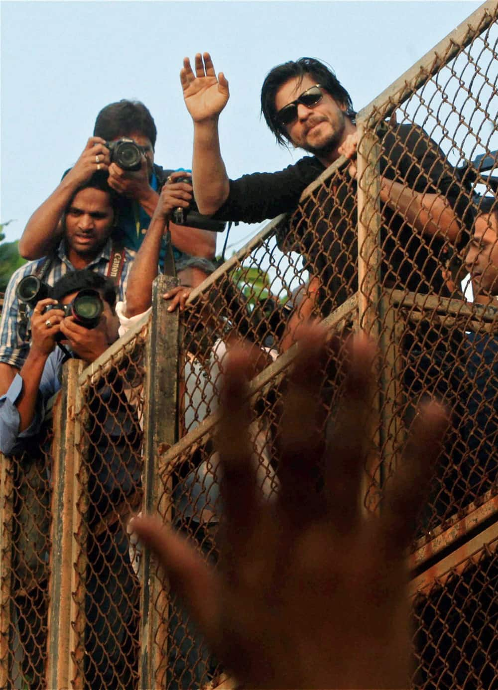 Shahrukh Khan waves to his fans on his birthday in Mumbai.