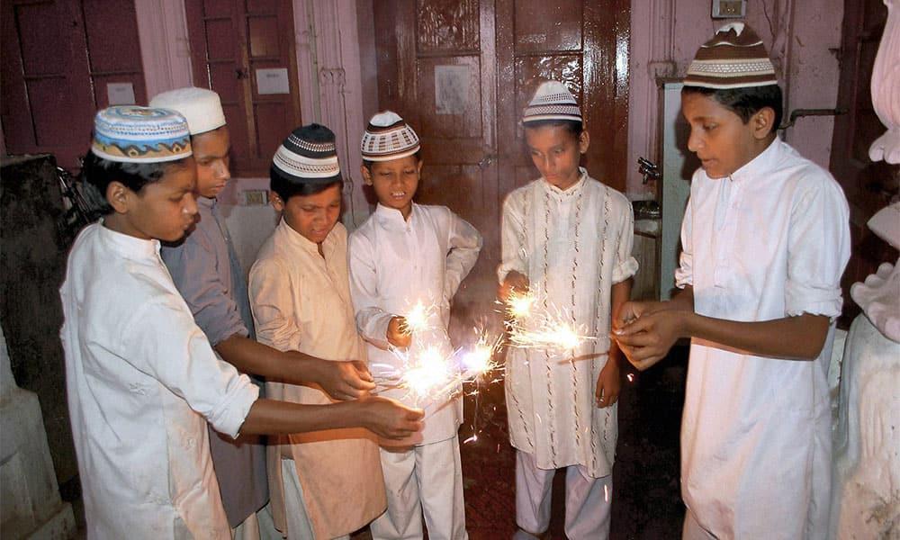 Muslim children celebrating Diwali with sparklers at a Madarsa in Mirzapur.