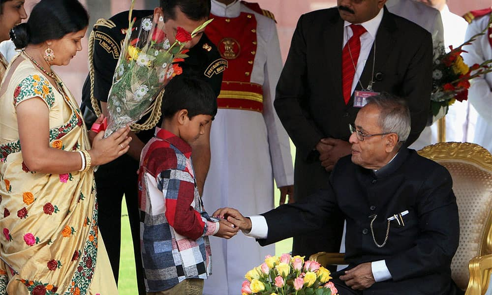 President Pranab Mukherjee being greeted by children on the occasion of Diwali at Rashtrapati Bhawan in New Delhi.