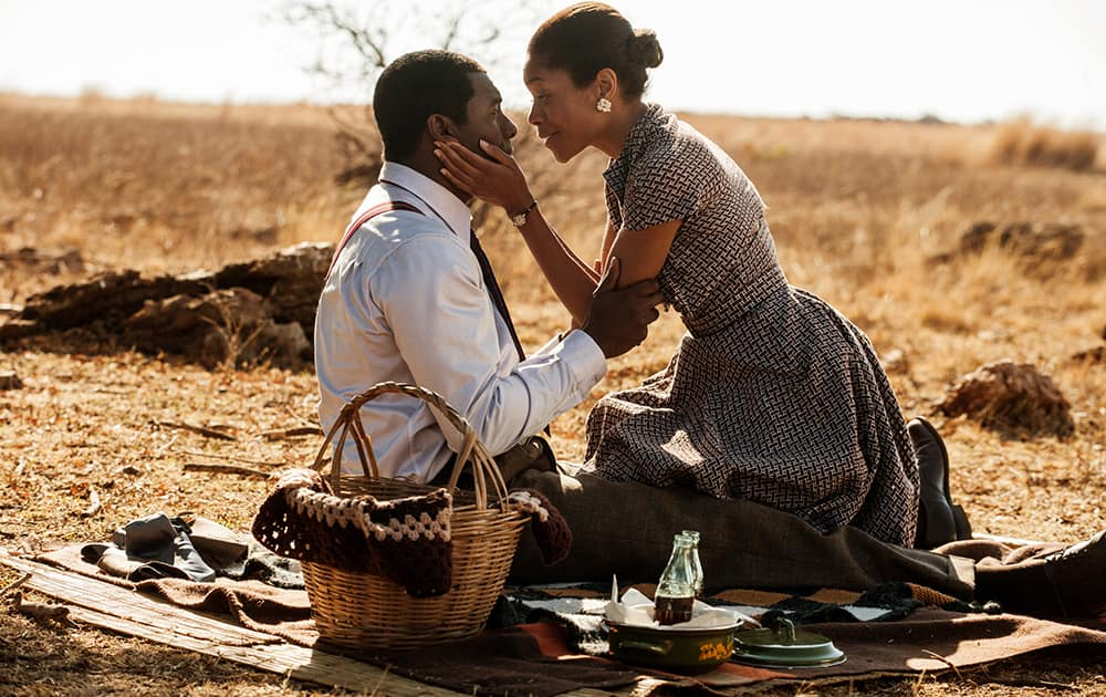 This image shows Idris Elba, as Nelson Mandela, left, and Naomie Harris as Winnie Mandela in a scene from