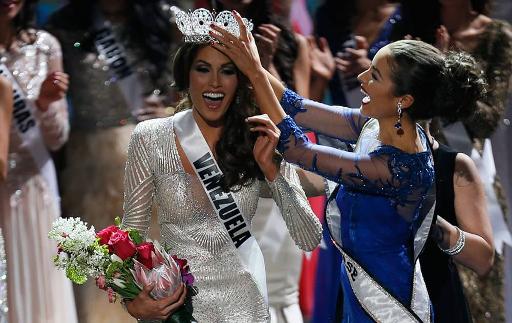 Miss Universe 2012 Olivia Culpo, from the United States, right, places the crown on Miss Venezuela Gabriela Isler during the 2013 Miss Universe pageant in Moscow, Russia.