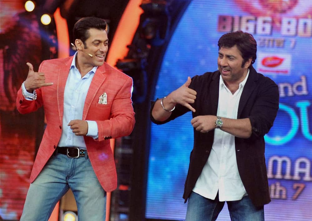 Bollywood actors Salman Khan with Sunny Deol during the promotion of his forthcoming Hindi Film 'Singh Saab The Great' on the set of Colors 'Bigg Boss 7' TV Reality Show in Lonavala.