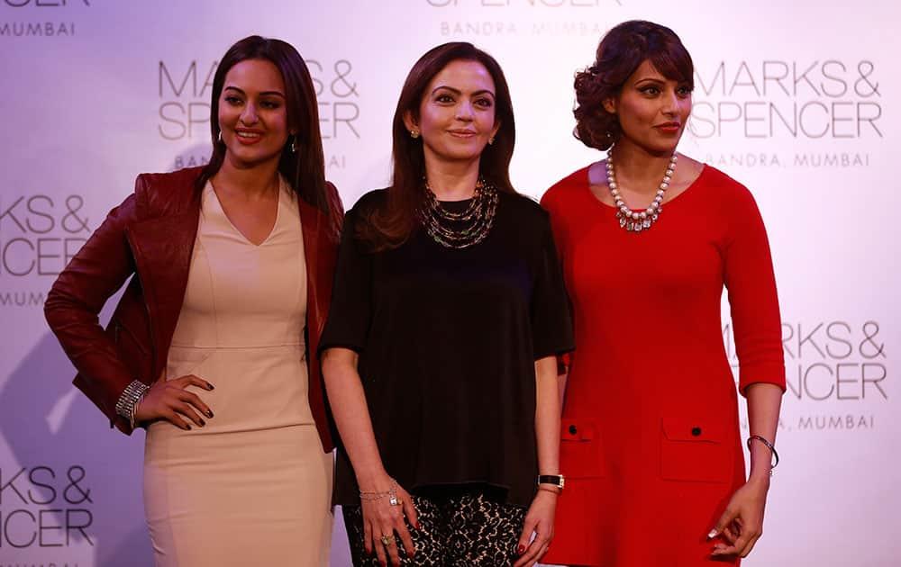 Indian businesswoman Nita Ambani, center, poses with Bollywood actors Sonakshi Sinha, left, and Bipasha Basu during the opening of Marks & Spencer's biggest store in India, Mumbai, India.