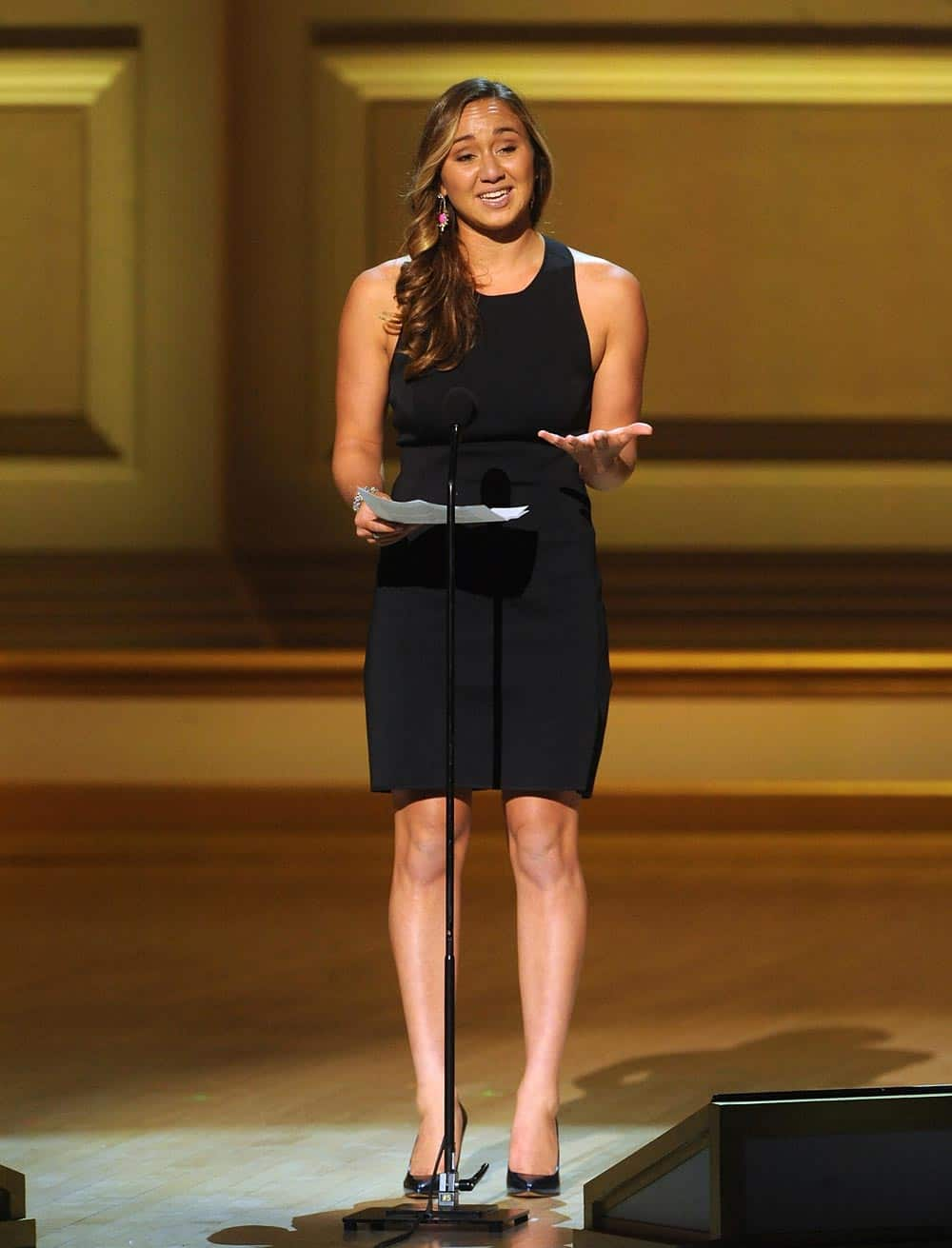 Surfer Carissa Moore accepts the Game Changer Award on stage at the 2013 Glamour Women of the Year Awards, in New York.