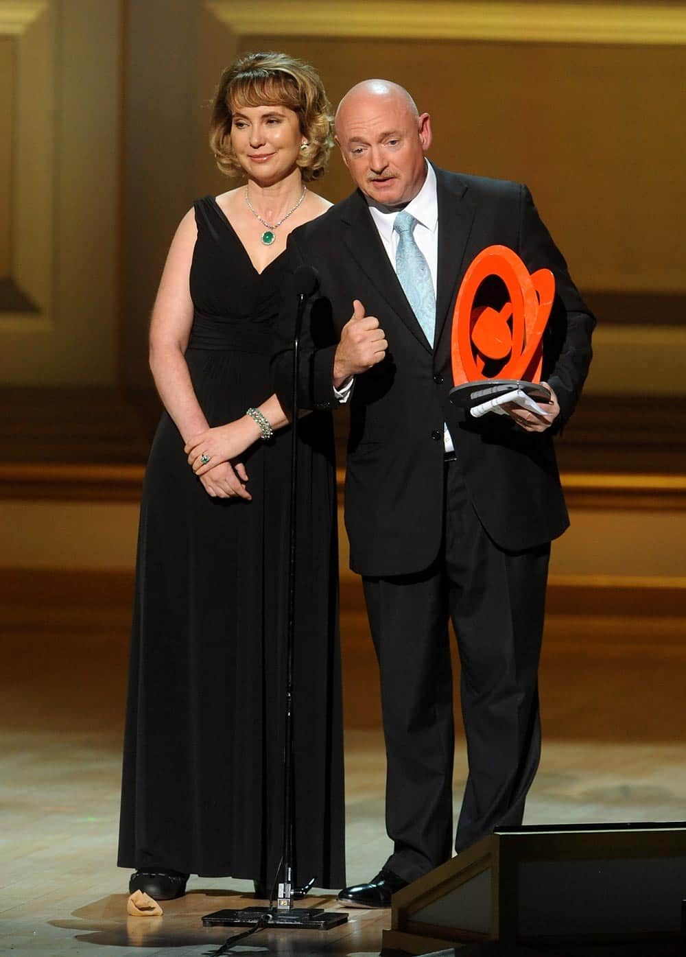 US Representative Garbrielle Giffords and husband Retired US Navy Captain and NASA Astronaut Mark Kelly accept The Couple of the Year Award on stage at the 2013 Glamour Women of the Year Awards.