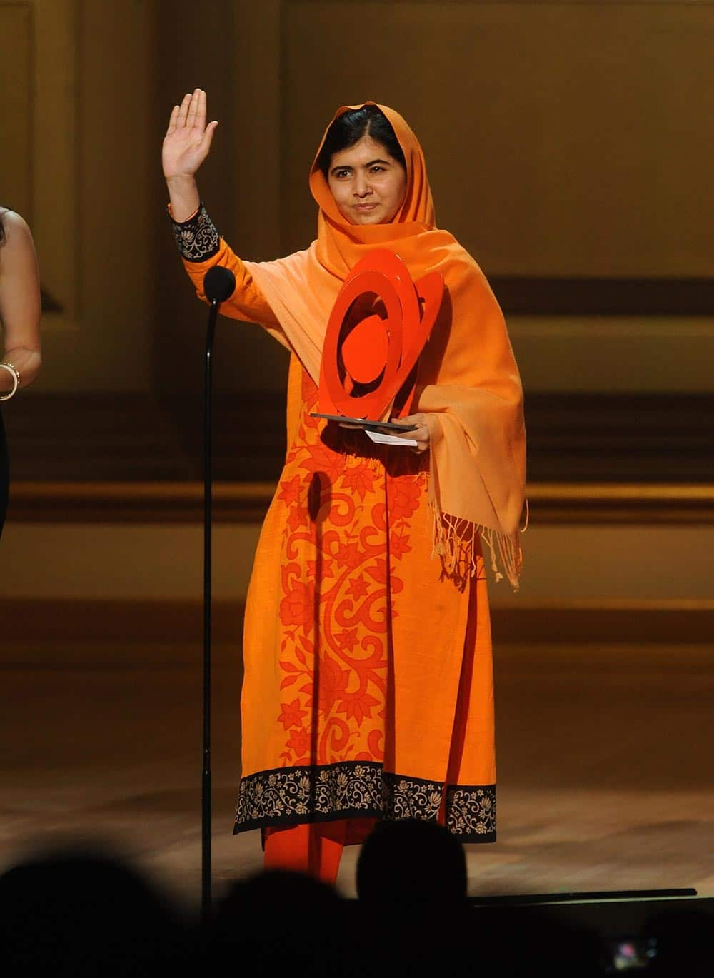 Education activist Malala Yousafzai accepts The Women of the Year Fund Honoree Award on stage at the 2013 Glamour Women of the Year Awards, in New York.