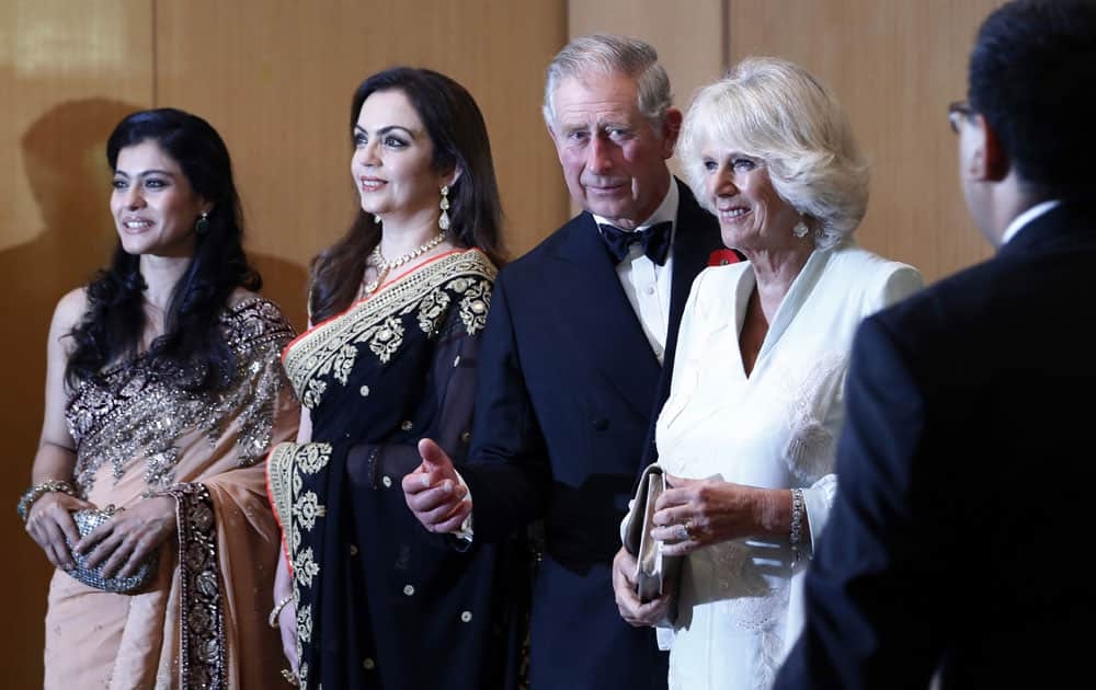 Britain's Prince Charles and his wife Camilla, the Duchess of Cornwall, stand with Bollywood actress Kajol, businesswoman Nita Ambani, industrialist Mukesh Ambani and Bollywood actor Ajay Devgan before a dinner to support the work of British Asian Trust in Mumbai.