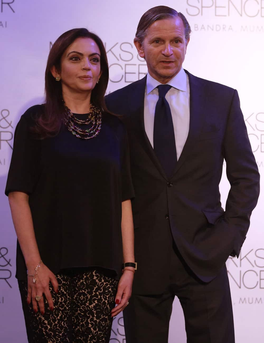 Marks & Spencer chief executive Marc Bolland, poses for photographers with Indian businesswoman Nita Ambani, left during the opening of their biggest store in India, Mumbai.