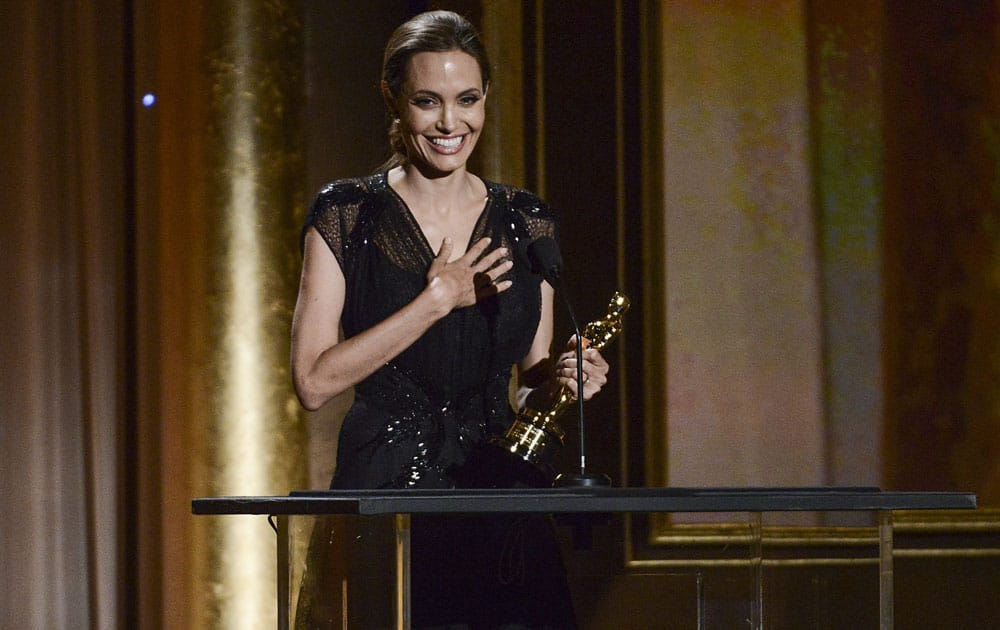 Actress and honoree Angelina Jolie accepts her award at the 2013 Governors Awards in Los Angeles.