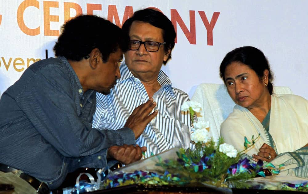 West Bengal Chief Minister Mamata Banerjee, noted Director Goutam Ghosh (L) and actor Ranjit Mullick during Kolkata International Film Festival closing ceremony in Kolkata.