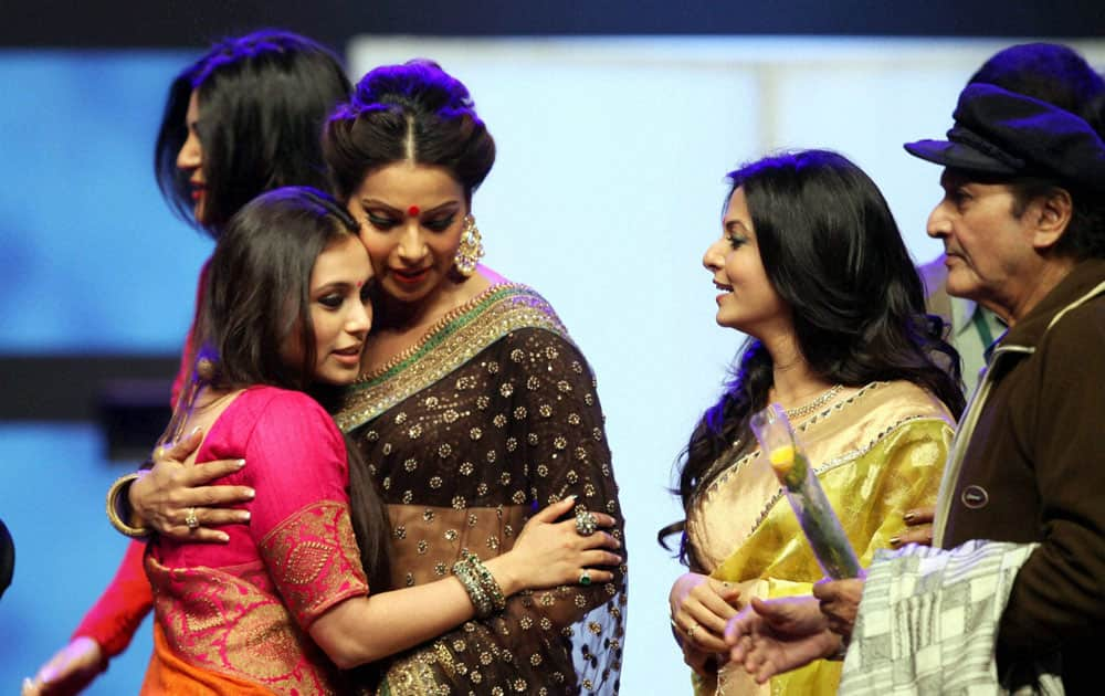 Bollywood actress Rani Mukherjee and Bipasha Basu hugs each other,while Susmita sen passes out at the backdrops and Tollywood actress Koel Mallick and Veteran actor Biswajit looks on during 19th Kolkata International Film Festival in Kolkata.