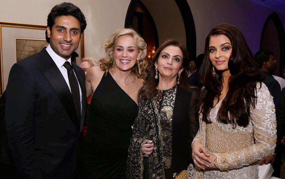 Abhishek Bachchan, Sharon Stone, Neeta Ambani and Aishwarya Rai Bachchan at the amfAR event in Mumbai.