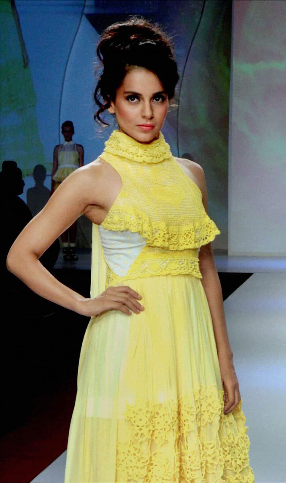 Bollywood Actress Kangana Ranaut walks the ramp at the Signature International Fashion Weekend 2013 in Mumbai.