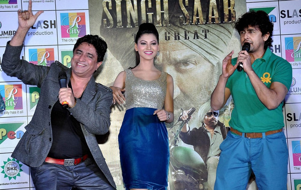 Actress Urvashi Rautela with Music Director Anand Raj Anand and singer Sonu Nigam during a promotional event for their upcoming film.