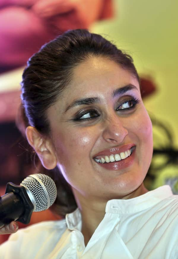 Bollywood actor Kareena Kapoor Khan smiles as she listens to her fellow actor Imran Khan during a press conference organized to promote her forthcoming movie Gori Tere Pyaar Mein (My Fair Lady, In Your Love) in Bangalore.