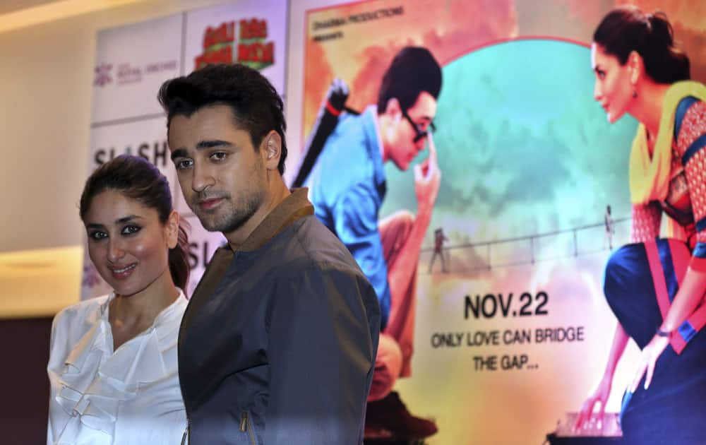 Bollywood actors Kareena Kapoor Khan, left, and Imran Khan pose for photographs after a press conference organized to promote her forthcoming movie Gori Tere Pyaar Mein, in Bangalore.