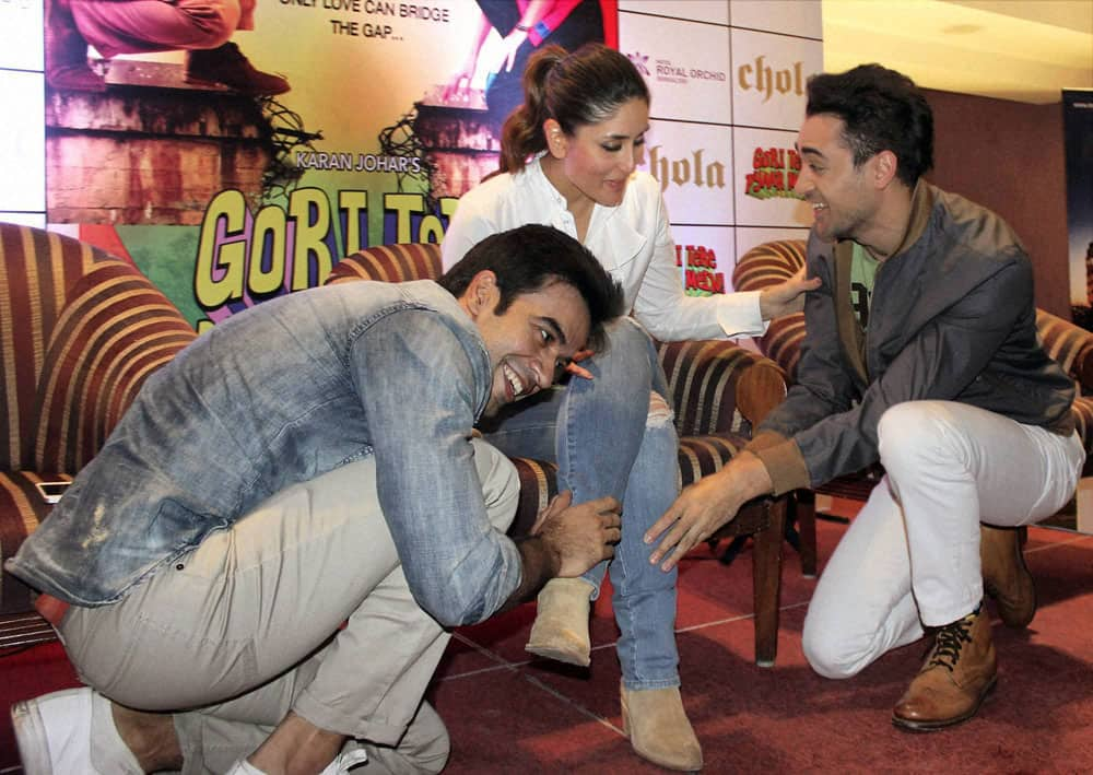 Bollywood Director Punit Malhotra with actors Imran Khan and Kareen Kapoor at a promotional event of their upcoming film 'Gori Tere Pyar Mein' in Bengaluru.