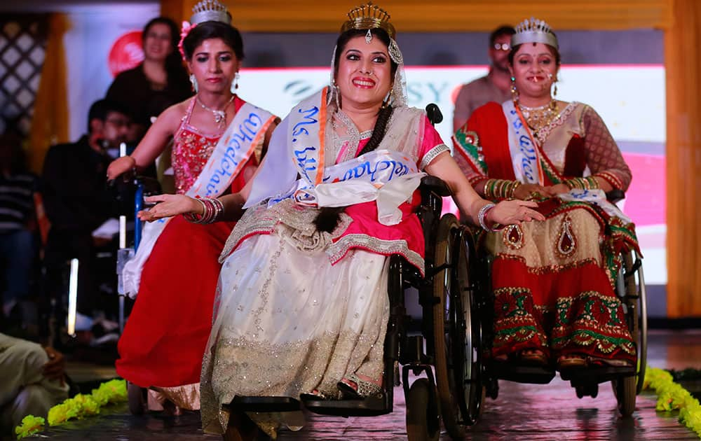 Nirmala, centre, smiles after being named Miss Wheelchair India Beauty during a beauty contest in Mumbai, India. 15 handicapped contestants took part in the event.