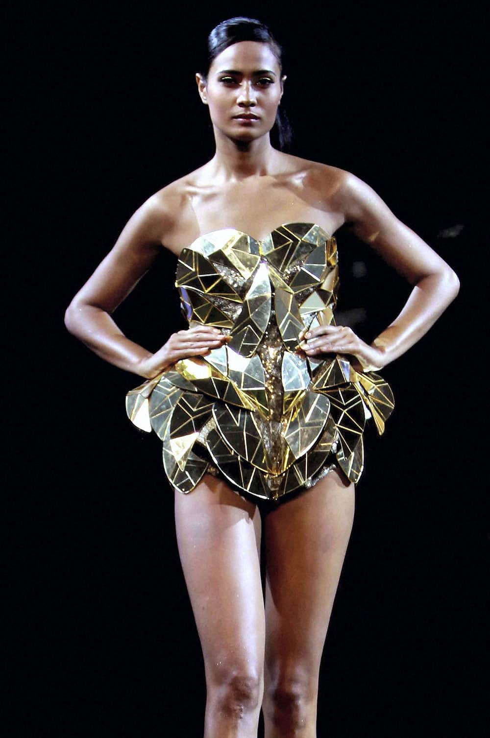 A model displays creation of Gavin Miguel during a fashion tour 2013, in Mumbai.