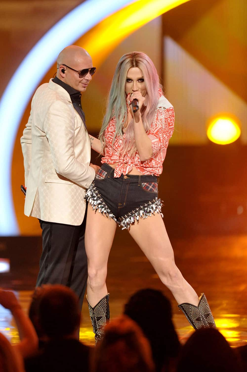 Pitbull, left, and Ke$ha perform at the American Music Awards at the Nokia Theatre L.A.