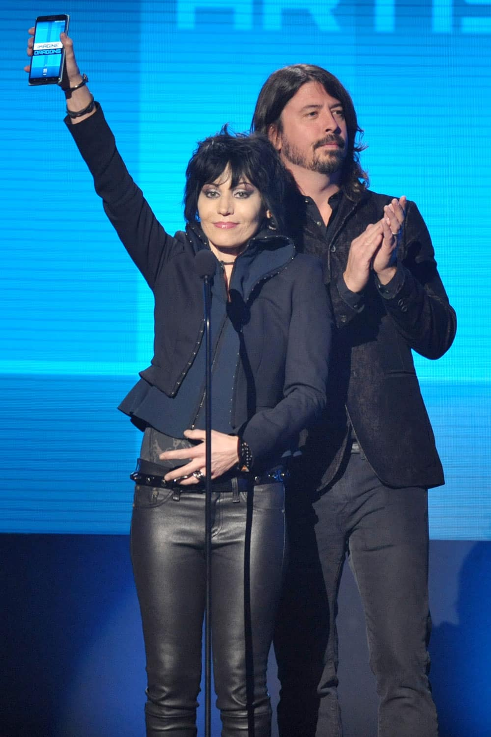 Joan Jett, left, and Dave Grohl present the award for favorite artist - alternative rock at the American Music Awards at the Nokia Theatre L.A.