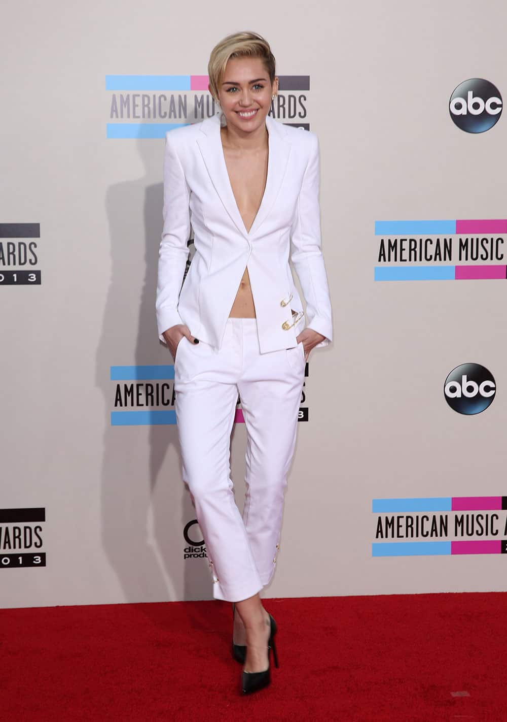 Miley Cyrus arrives at the 2013 American Music Awards.