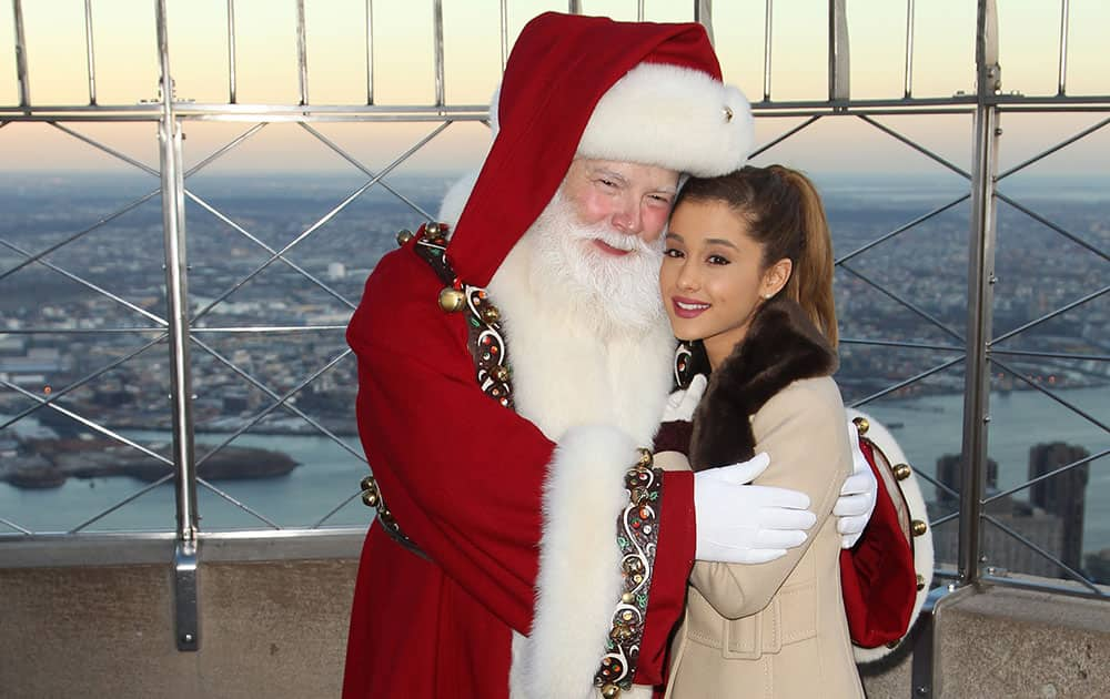 Santa Claus and singer Ariana Grande are seen at the Empire State Building Lighting where they officially kick-off Macy's Thanksgiving Day Parade week  in New York.
