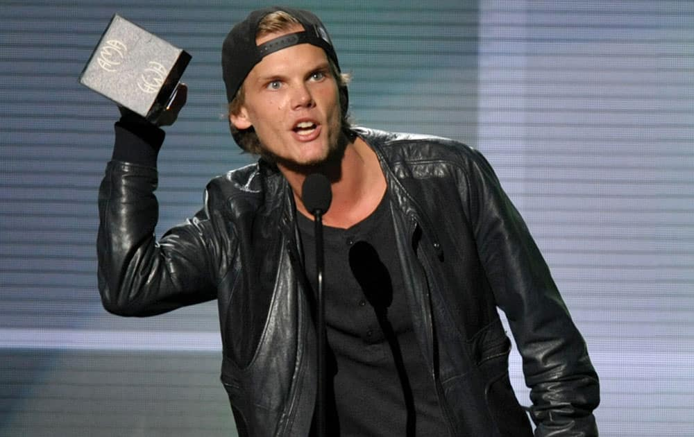 Avicii accepts the award for favorite artist - electronic dance music at the American Music Awards at the Nokia Theatre L.A.
