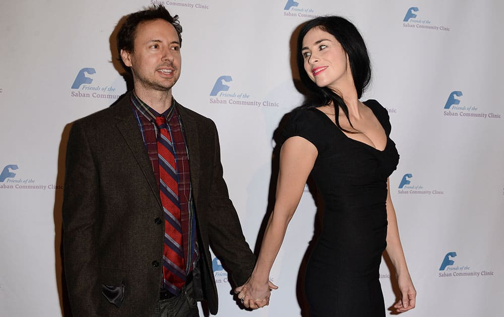 Actress and comedian Sarah Silverman, right, and comedian Kyle Dunnigan arrive at the Saban Community Clinic's benefit gala at the Beverly Hilton in Beverly Hills, Calif.