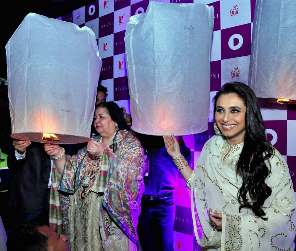 Rani Mukherjee and Pamela Chopra light wishing lanterns at a promotional event in New Delhi.