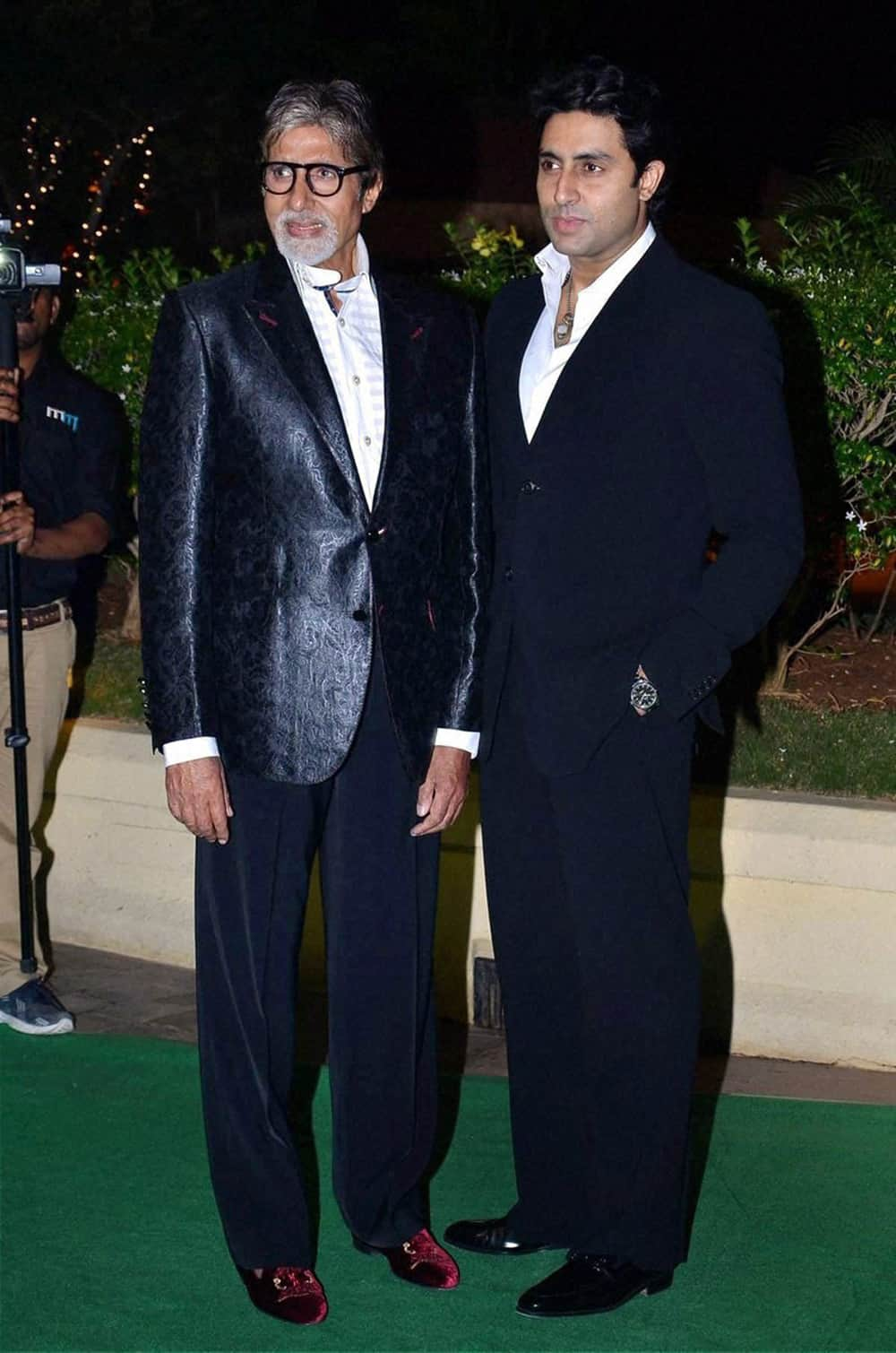 Amitabh Bachchan and Abhishek Bachchan at the wedding reception of Mahesh Bhatt's son Vishesh Bhatt in Mumbai.