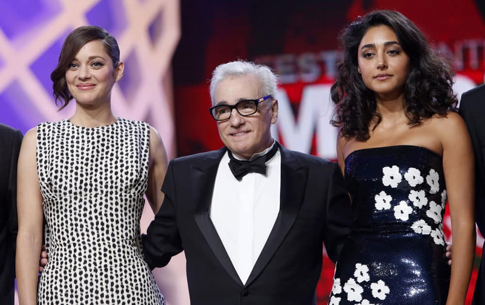 Jury members, French actress Marion Cotillard and US film director Martin Scorsese and Iranian actress Golshifteh Farahani, right, pose during the opening ceremony at the Marrakech International Film Festival in Marrakech.