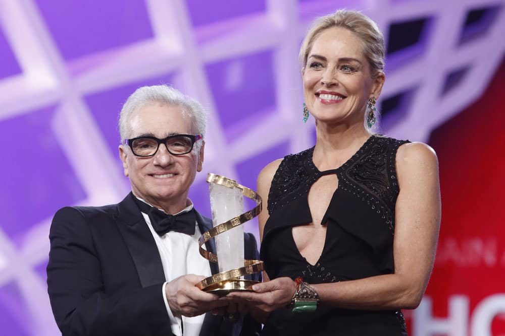 US actress Sharon Stone recieves a trophy in tribute to her lifetime career, from American film director Martin Scorsese, left, during the opening ceremony at the Marrakech International Film Festival in Marrakech.