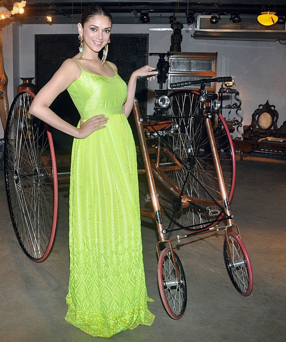 Aditi Rao Hyadri poses for the photographers during an event in Mumbai.