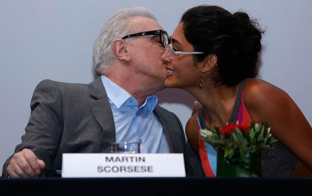 President of the jury of the Marrakech International Film Festival, left, US film director Martin Scorsese, left, kisses Iranian actress and jury member Golshifteh Farahani, during a news conference at the Marrakech International Film Festival in Marrakech, Morroco.