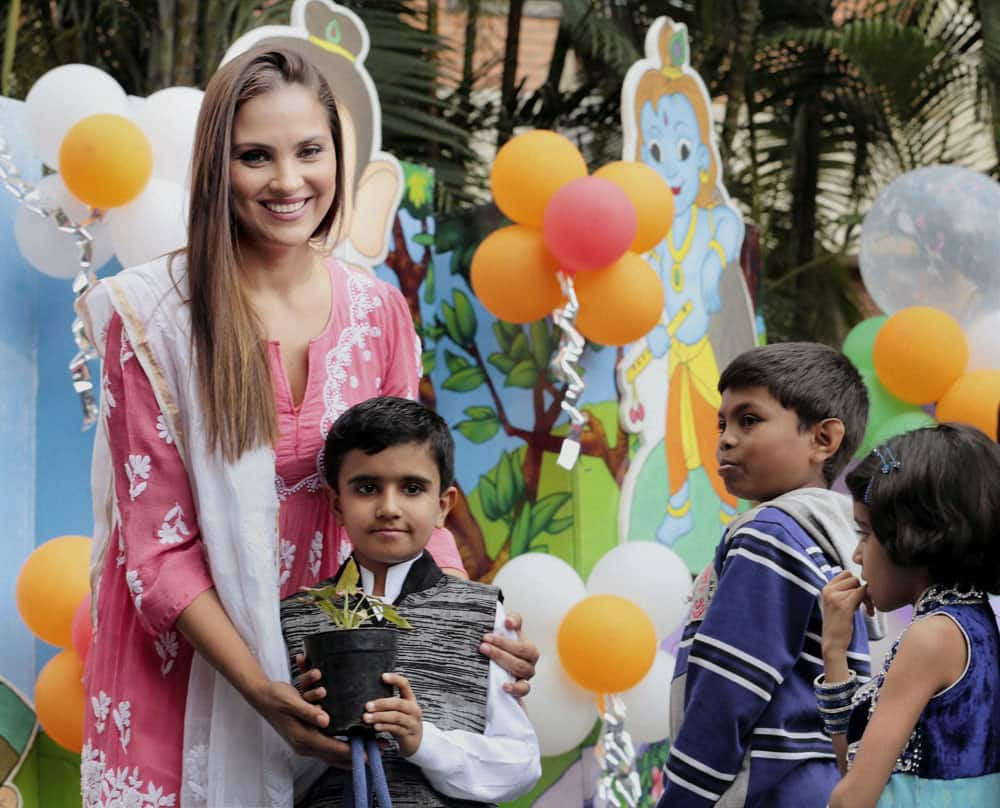 Actor Lara Dutta along with children suffering from cancer at the launch of a campaign against cancer in Bengaluru.