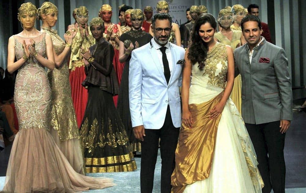 Tennis player Sania Mirza dispays a collection with Designer Shantanu & Nikhil during the fourth day of India Bridal Fashion Week in Mumbai.