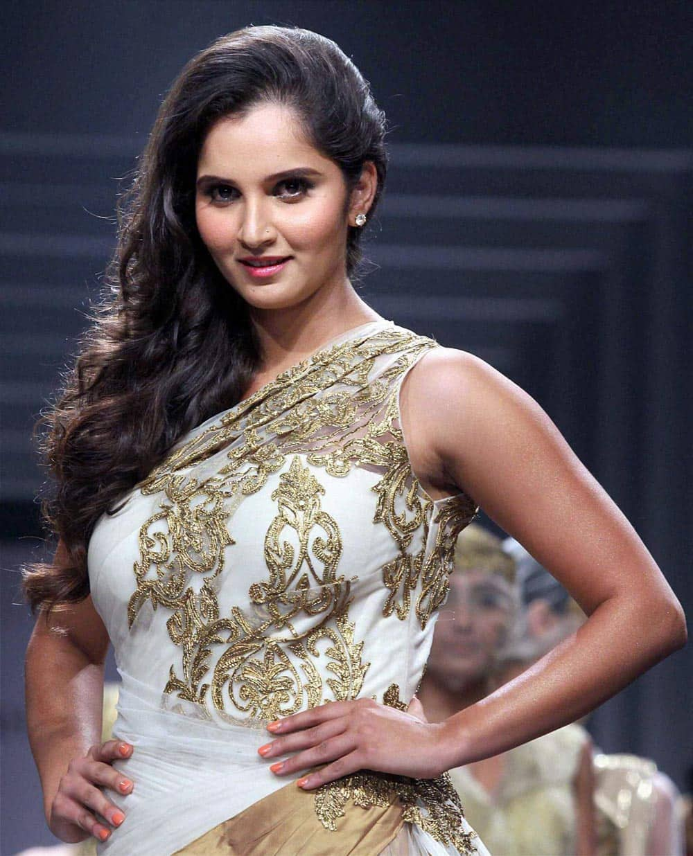 Tennis player Sania Mirza dispays a collection during the fourth day of India Bridal Fashion Week in Mumbai.